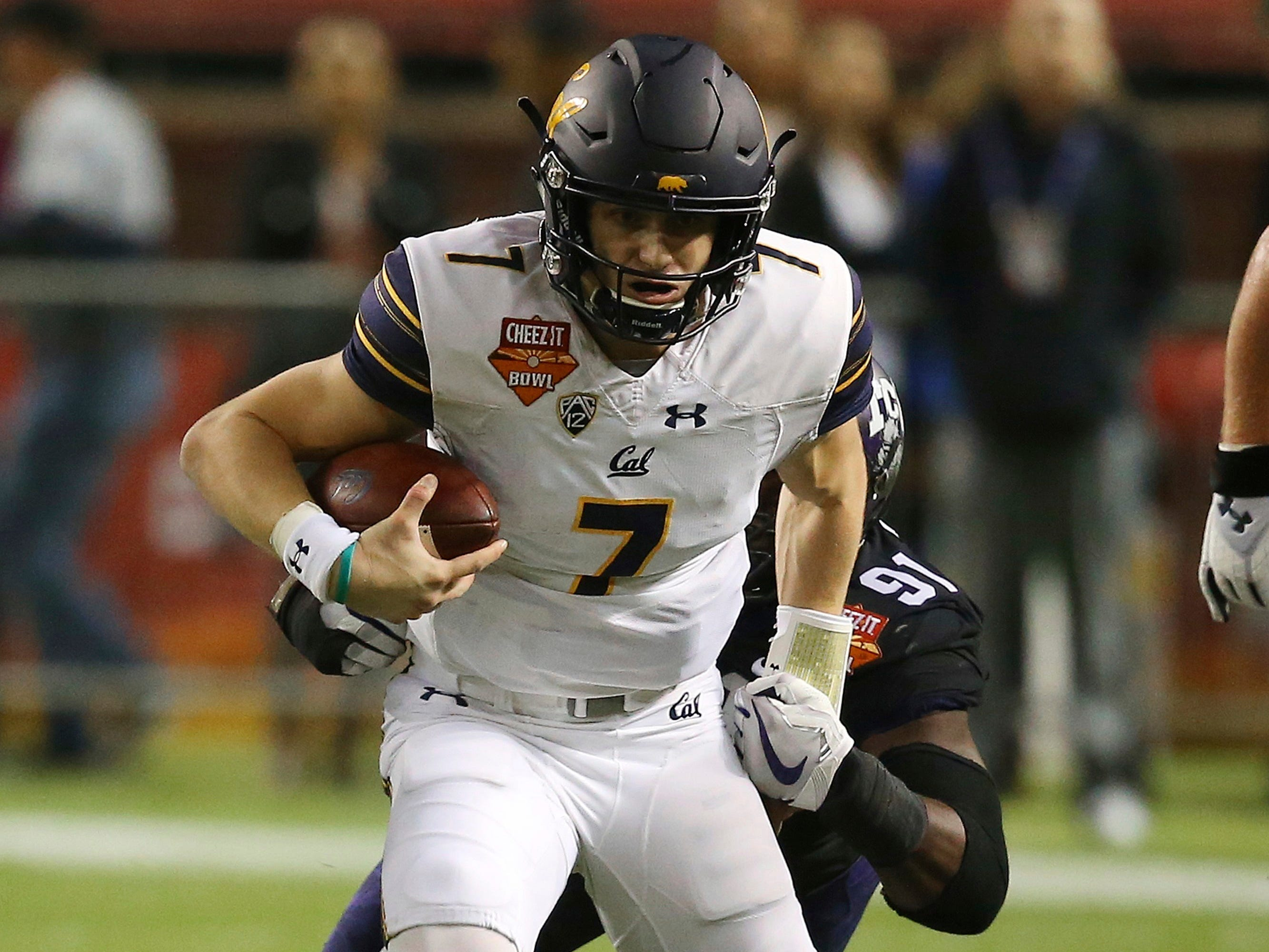 California quarterback Chase Garbers (7) gets brought down by TCU defensive end L.J. Collier (91) during the first half of the Cheez-It Bowl NCAA college football game Wednesday, Dec. 26, 2018, in Phoenix.