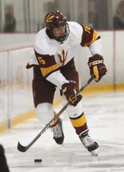 Austin Lemeiux carries the puck up the ice during a game against Alaska Fairbanks on Oct. 7 at Oceanside Ice Arena.