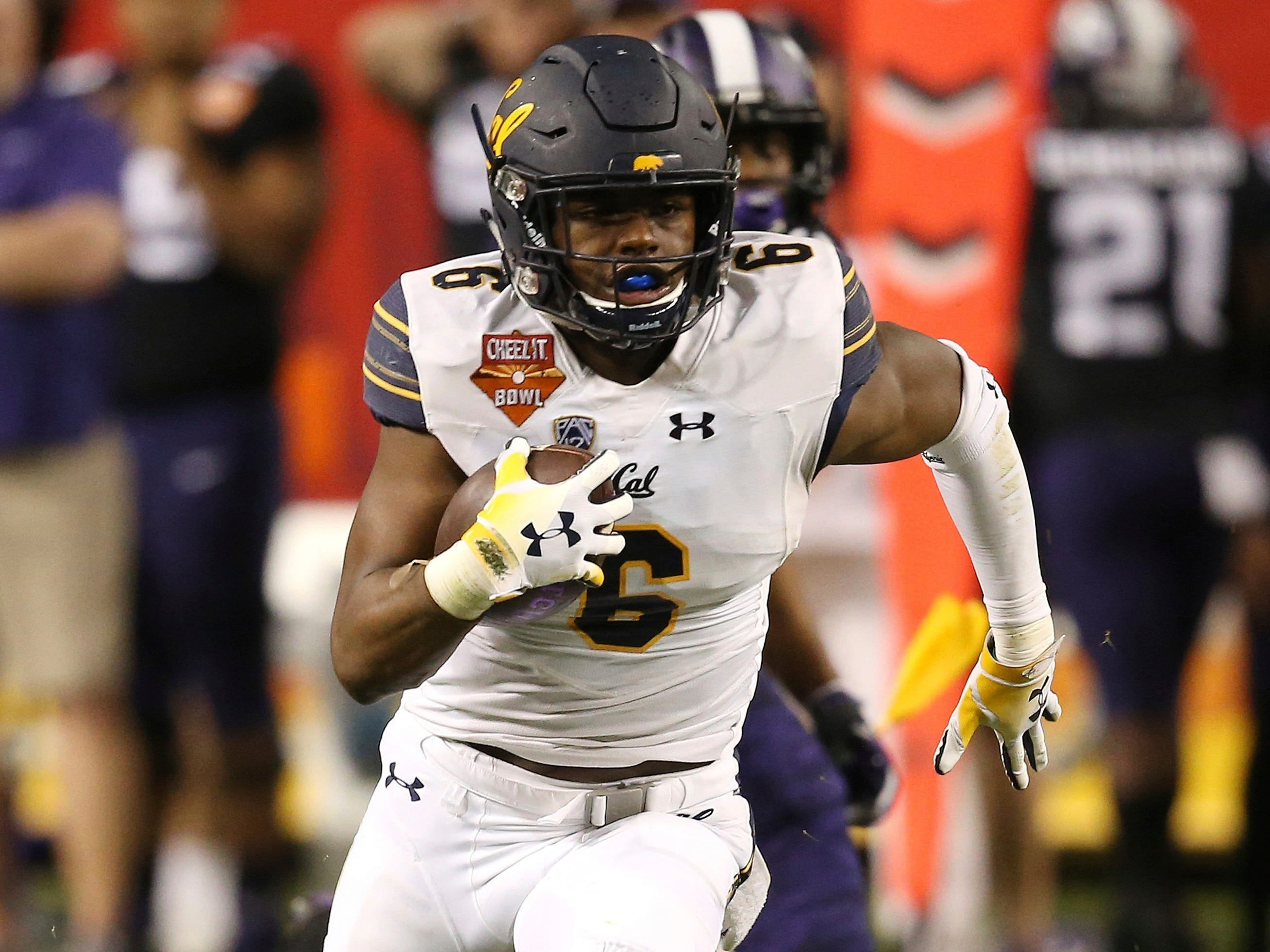 California safety Jaylinn Hawkins runs with the ball after intercepting a TCU pass during the first half of the Cheez-It Bowl NCAA college football game Wednesday, Dec. 26, 2018, in Phoenix.