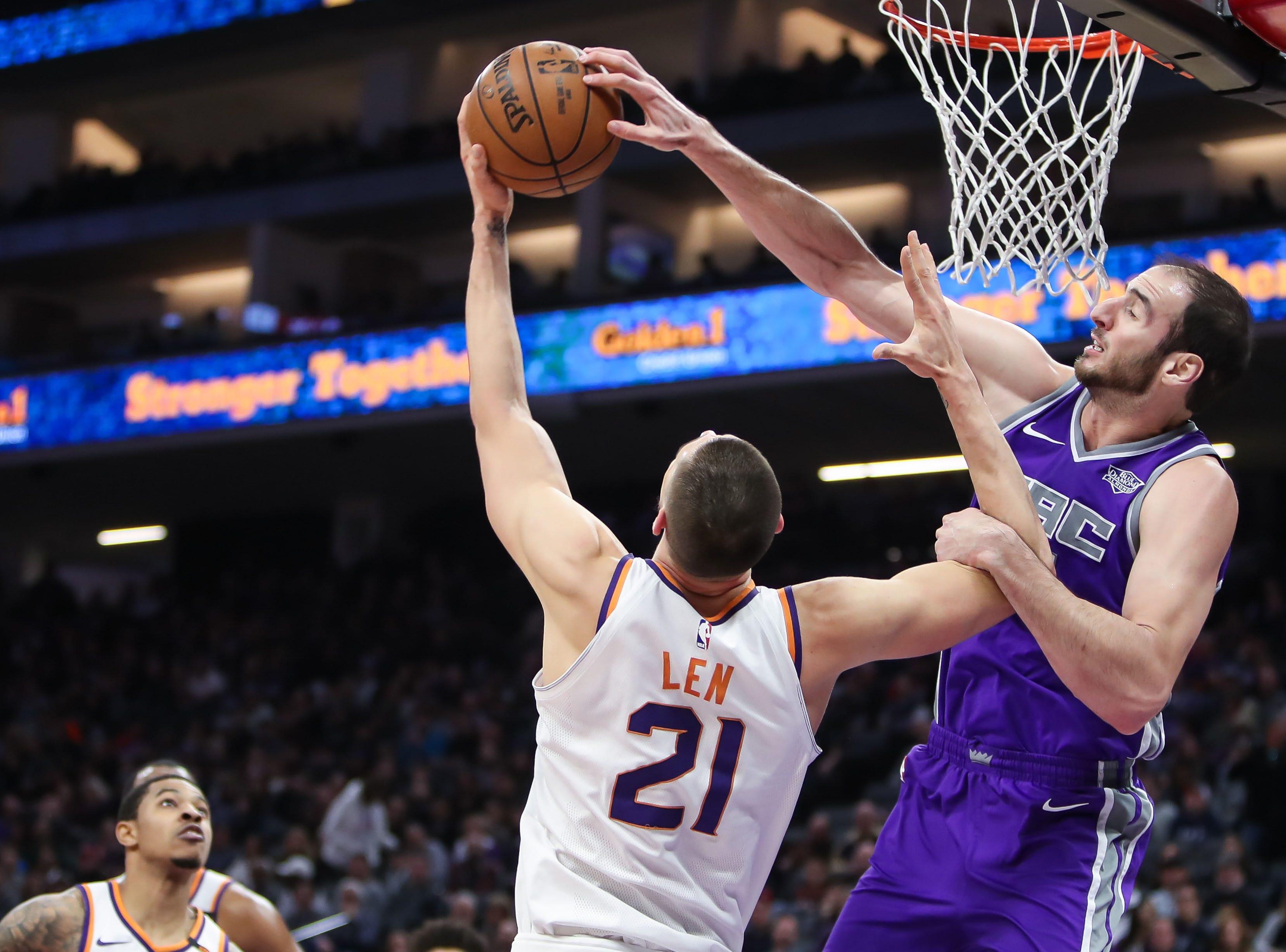 Dec 29, 2017; Sacramento, CA, USA; Sacramento Kings center Kosta Koufos (41) and Phoenix Suns center Alex Len (21) fight for a rebound during the second quarter at Golden 1 Center. Mandatory Credit: Sergio Estrada-USA TODAY Sports