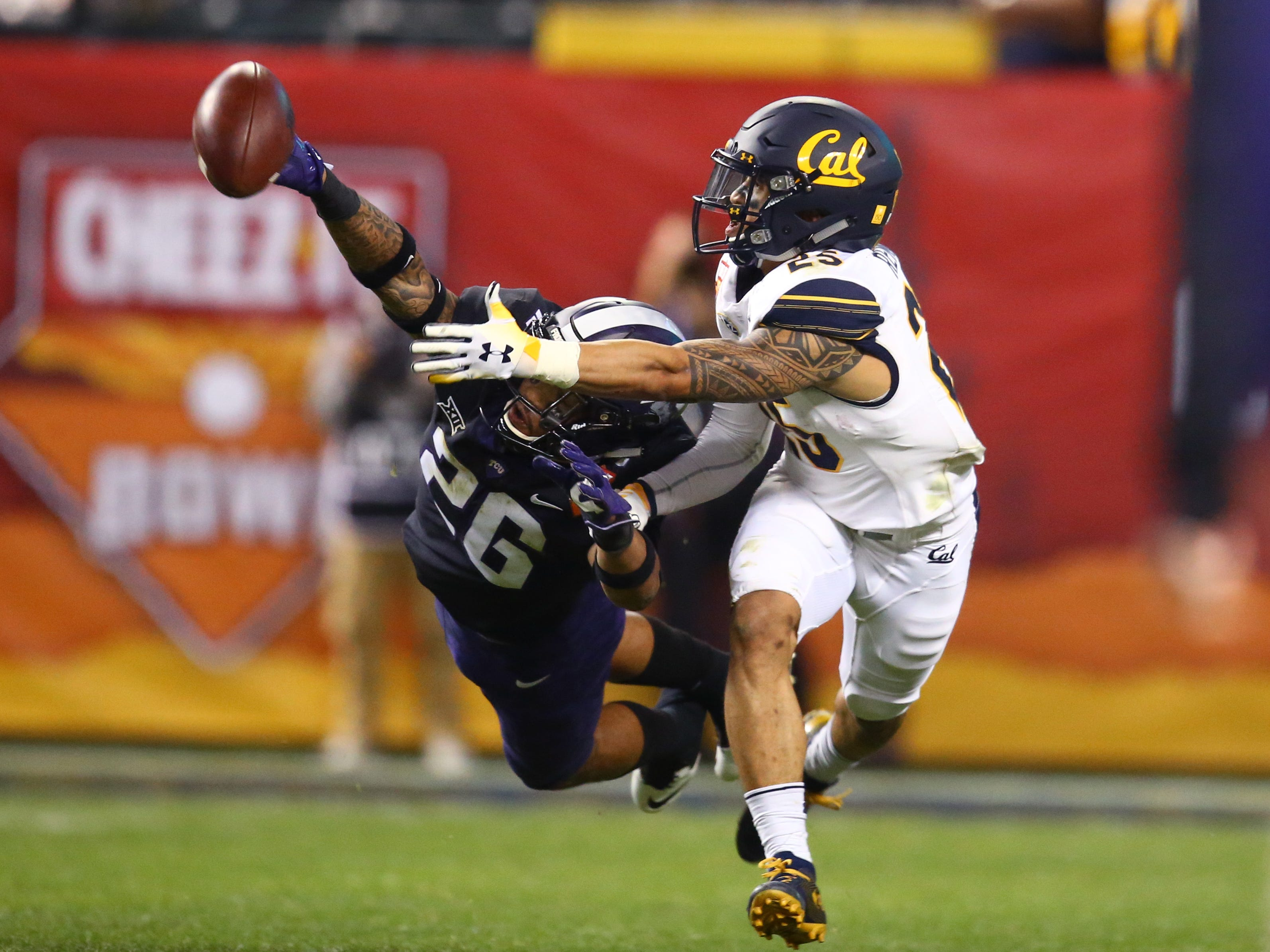 Dec 26, 2018; Phoenix, AZ, USA; Texas Christian Horned Frogs safety Vernon Scott (26) breaks up a pass intended for California Golden Bears wide receiver Nikko Remigio (25) in the fourth quarter of the 2018 Cheez-It Bowl at Chase Field.