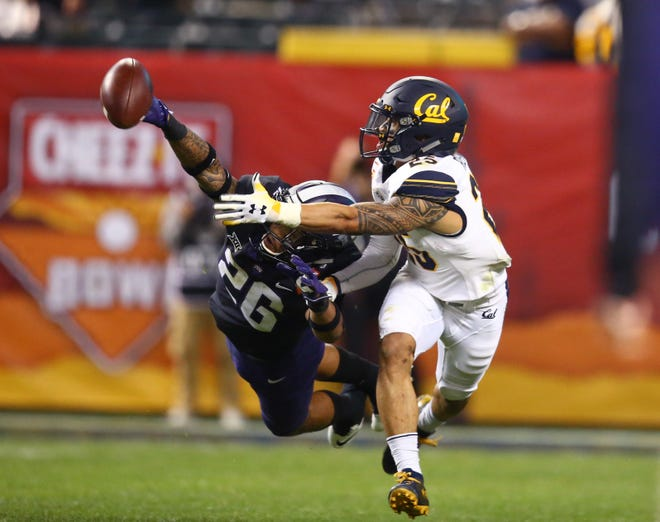 TCU safety Vernon Scottbreaks up a pass intended for Cal wide receiver Nikko Remigio during the 2018 Cheez-It Bowl in Phoenix.