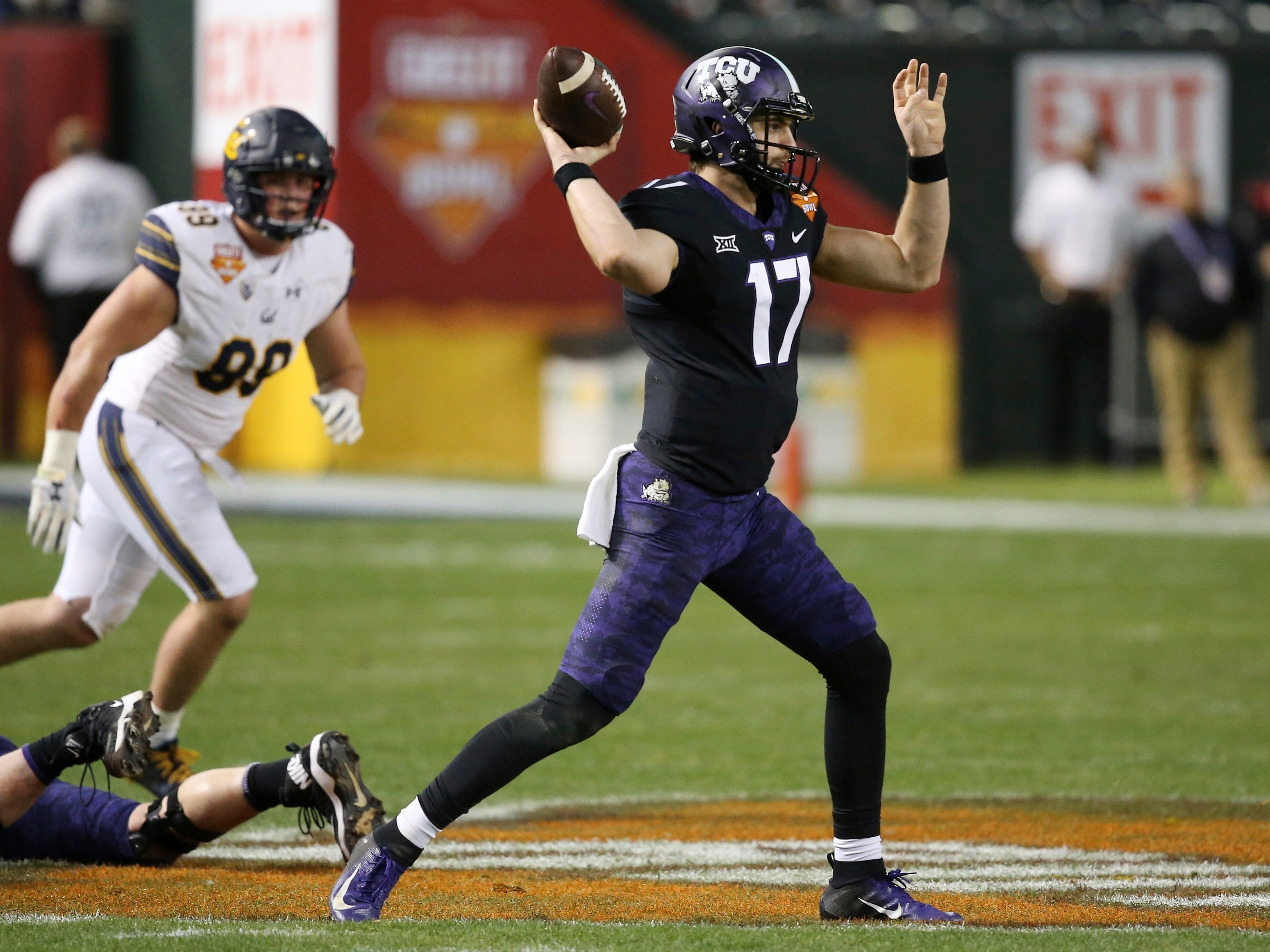 TCU quarterback Grayson Muehlstein (17) throws a pass as California linebacker Evan Weaver, left, watches during the first half of the Cheez-It Bowl NCAA college football game Wednesday, Dec. 26, 2018, in Phoenix.