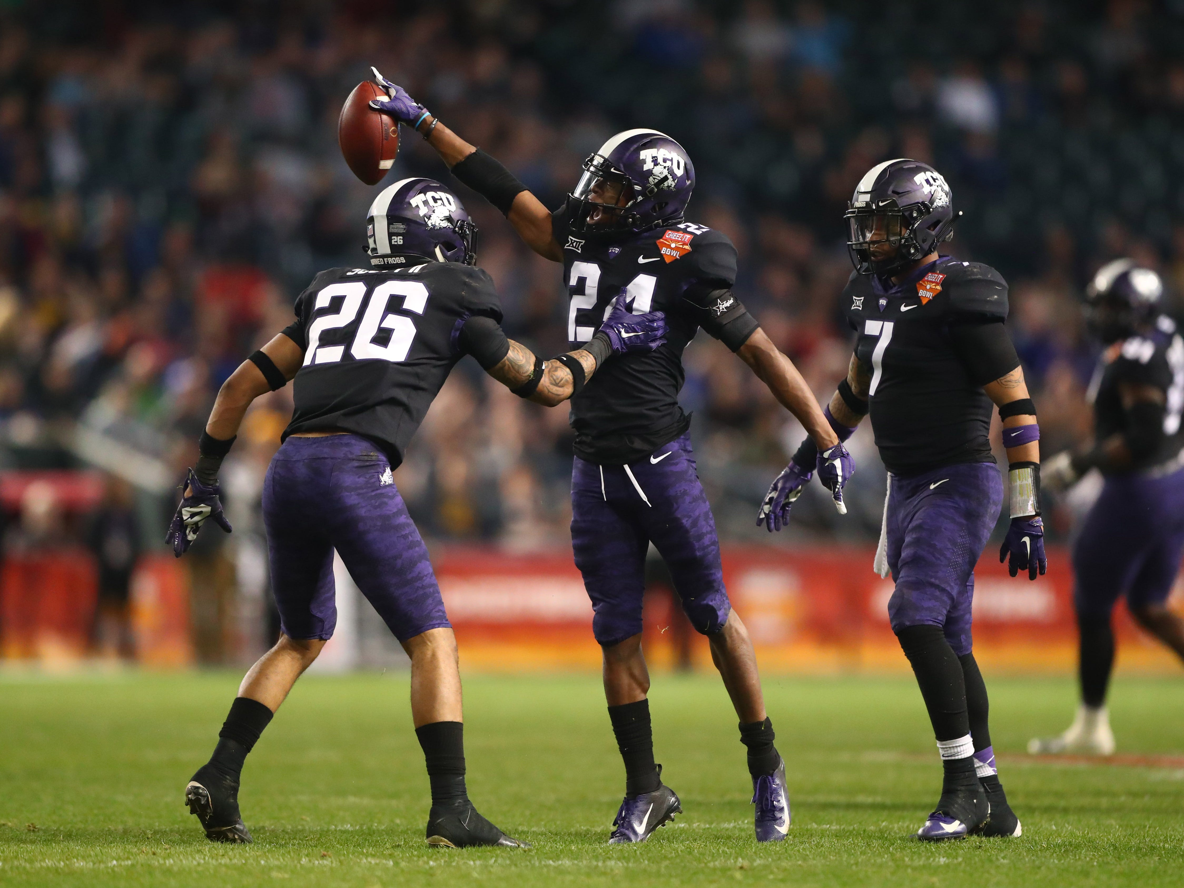 Dec 26, 2018; Phoenix, AZ, USA; Texas Christian Horned Frogs cornerback Julius Lewis (24) celebrates after an interception against the California Golden Bears in the first half of the 2018 Cheez-It Bowl at Chase Field.