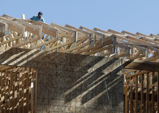 Arizona's gains in construction jobs could be at risk because of worker shortages. (AP Photo/David Zalubowski, File)