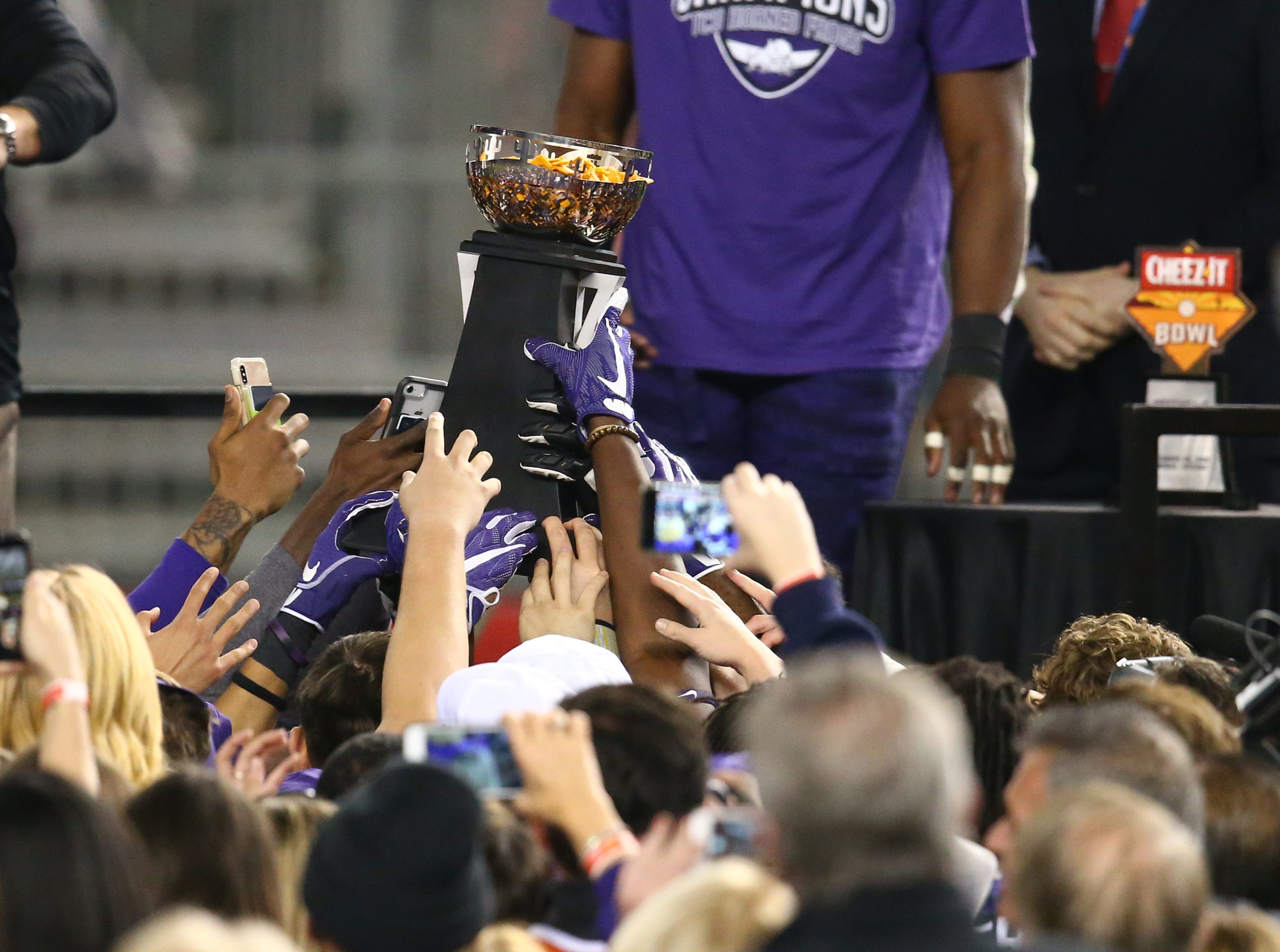 Dec 26, 2018; Phoenix, AZ, USA; Texas Christian Horned Frogs players celebrate with the trophy after defeating the California Golden Bears in overtime of the 2018 Cheez-It Bowl at Chase Field. Mandatory Credit: Mark J. Rebilas-USA TODAY Sports