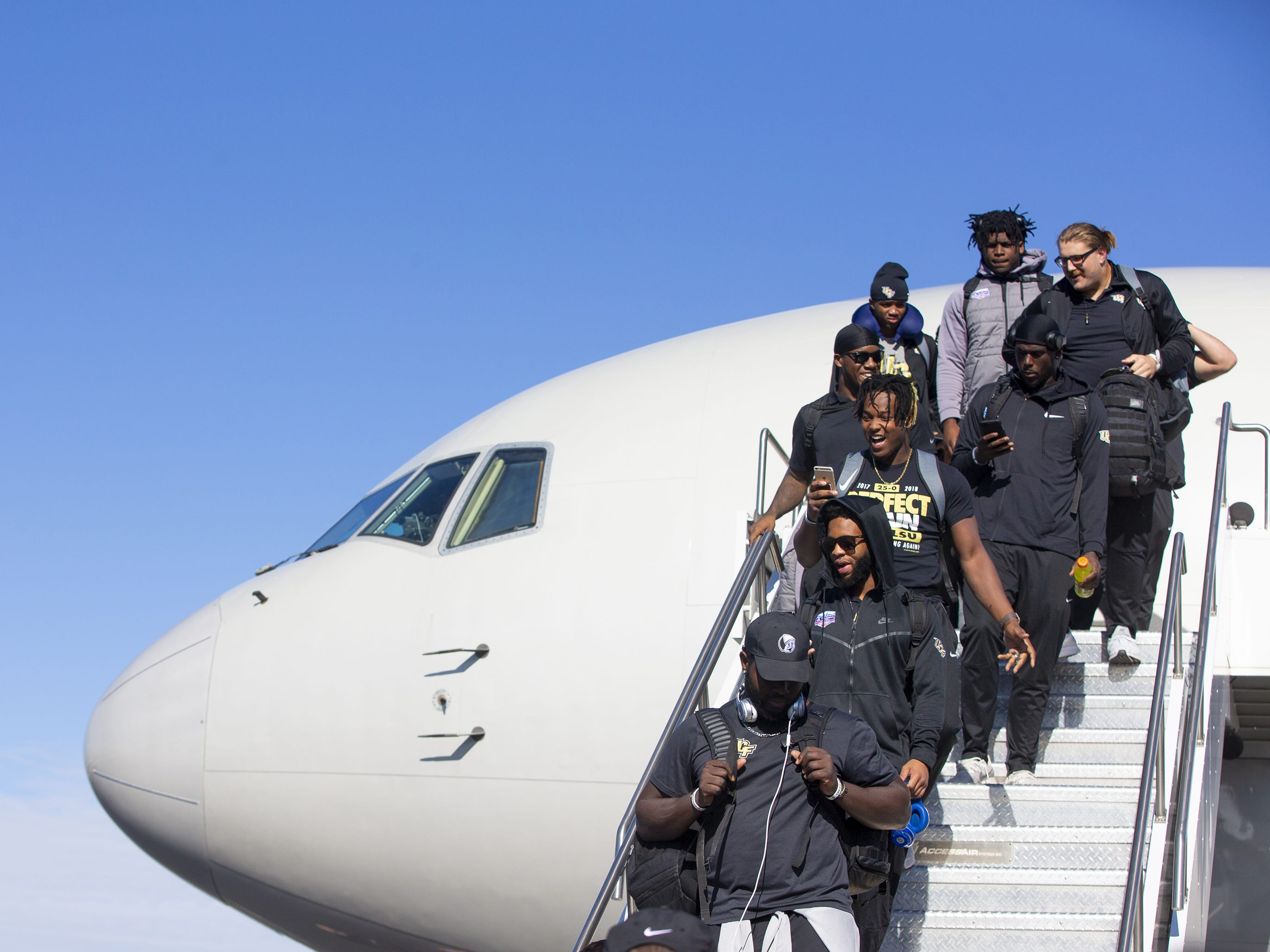Central Florida football team arrives at Sky Harbor International Airport in Phoenix on December 27. Central Florida will face LSU in the Fiesta Bowl on New Year's Day.