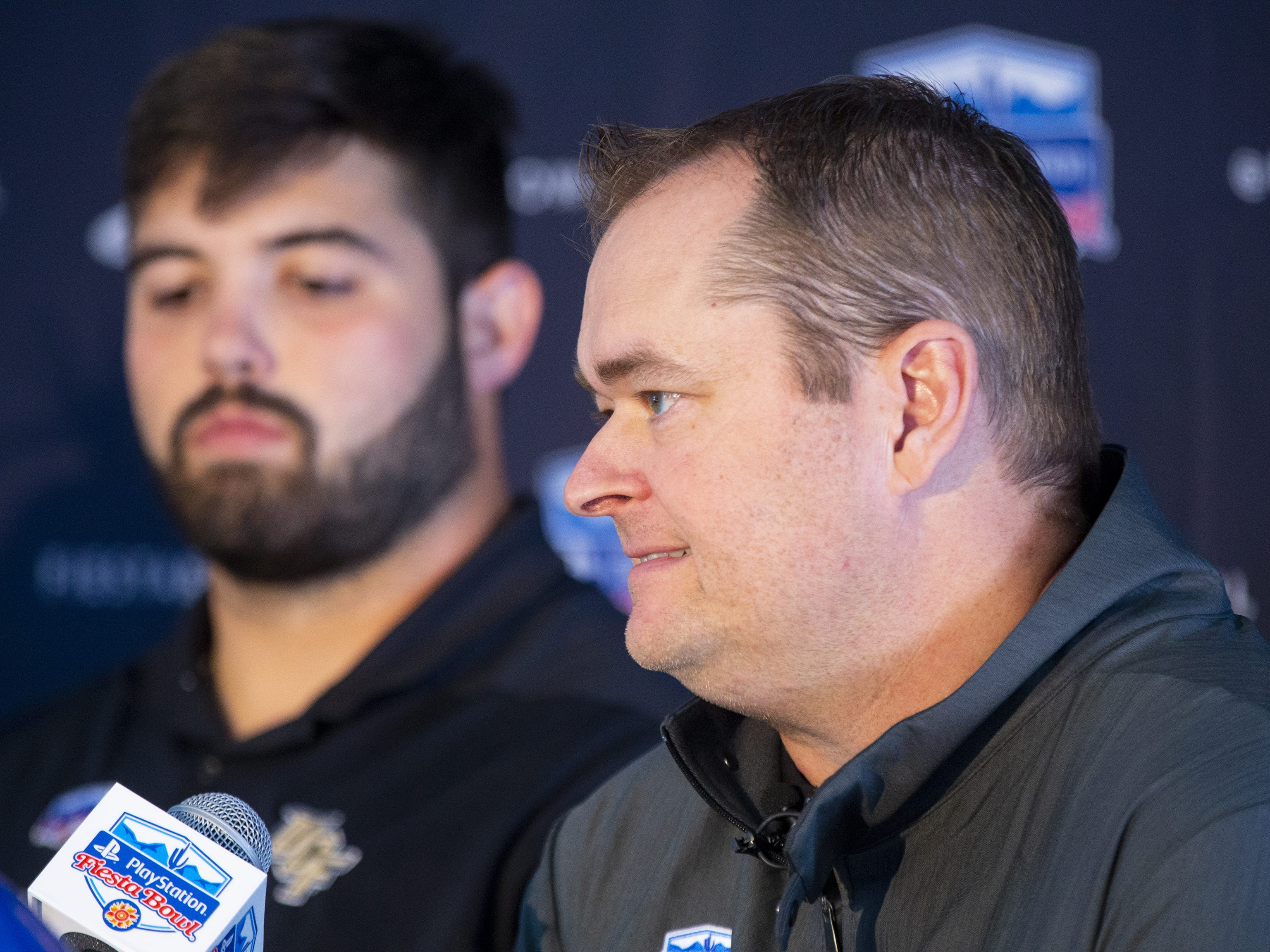 Central Florida head football coach Josh Heupel speaks to the media after arriving at Sky Harbor International Airport in Phoenix on December 27. Central Florida will face LSU in the Fiesta Bowl on New Year's Day.