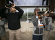 Angel Diaz (left), 10, Gumar Kueth (back right),12, and Andre Anderson, 9, all from the Tri-City West Thornwood Branch of Avondale of the Boys & Girls Clubs of Metro Phoenix, bird-watch at the Nina Mason Pulliam Rio Salado Audubon Center in Phoenix on Dec. 6, 2018.