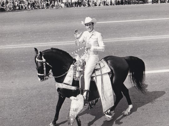 Ray Odom rides his stallion, Black Magic, in a Phoenix parade in the 1960s.