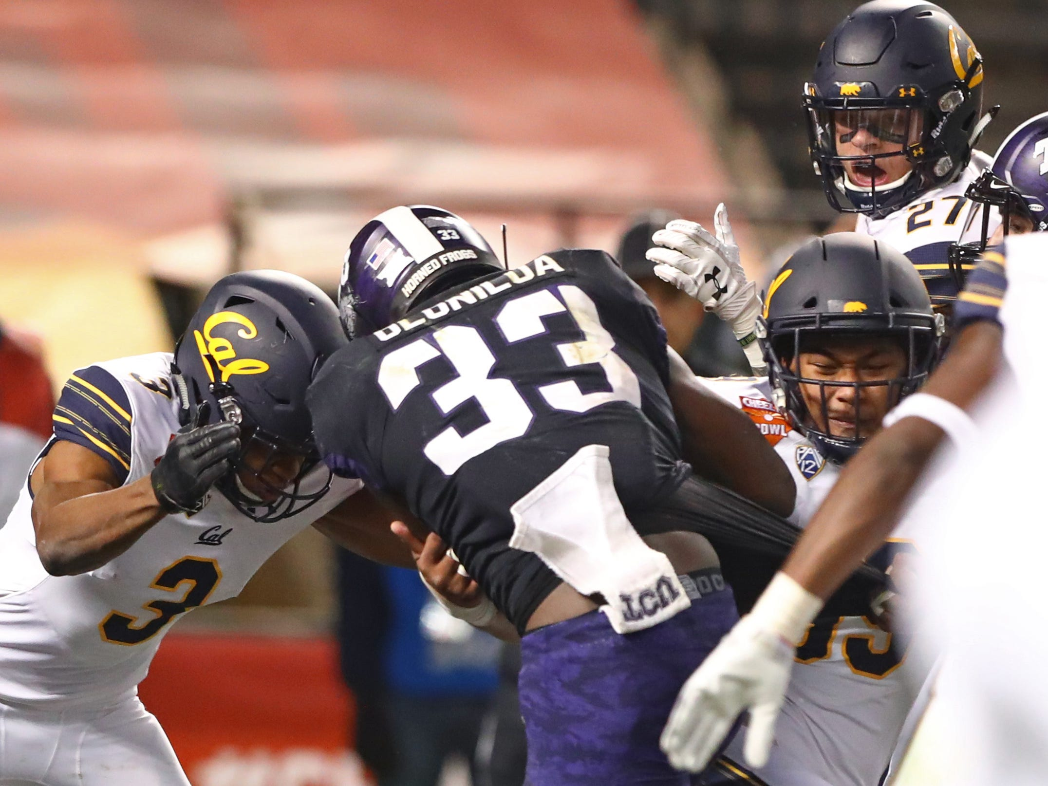 Dec 26, 2018; Phoenix, AZ, USA; Texas Christian Horned Frogs running back Sewo Olonilua (33) scores a second half touchdown against the California Golden Bears in the 2018 Cheez-It Bowl at Chase Field.