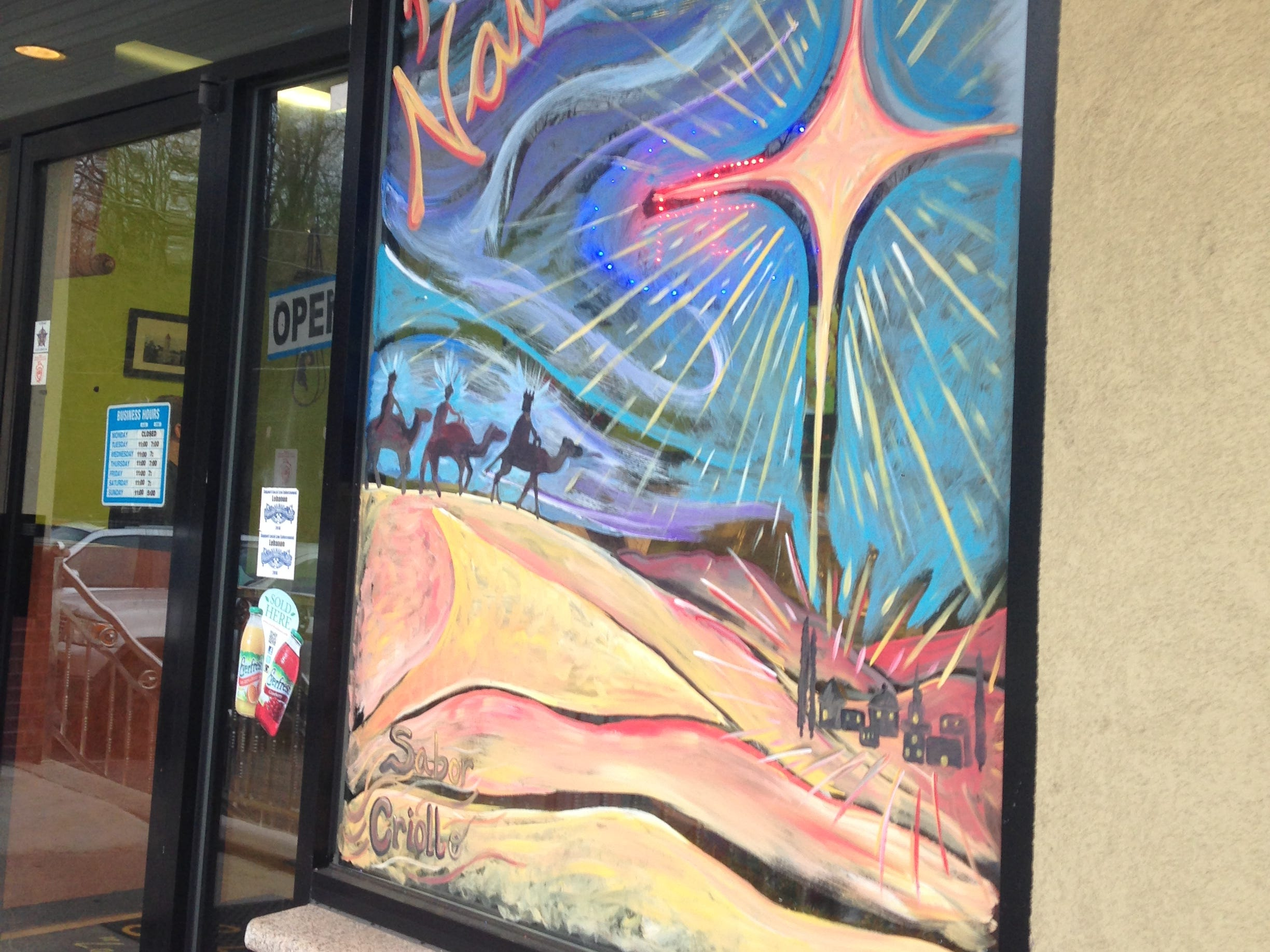 Storefront windows throughout downtown Lebanon have been painted to brighten up the community and have people feel better about what downtown Lebanon has to offer the community. the paintings have been done by Katie Trainer, with sponsorship assistance from Snitz Creek