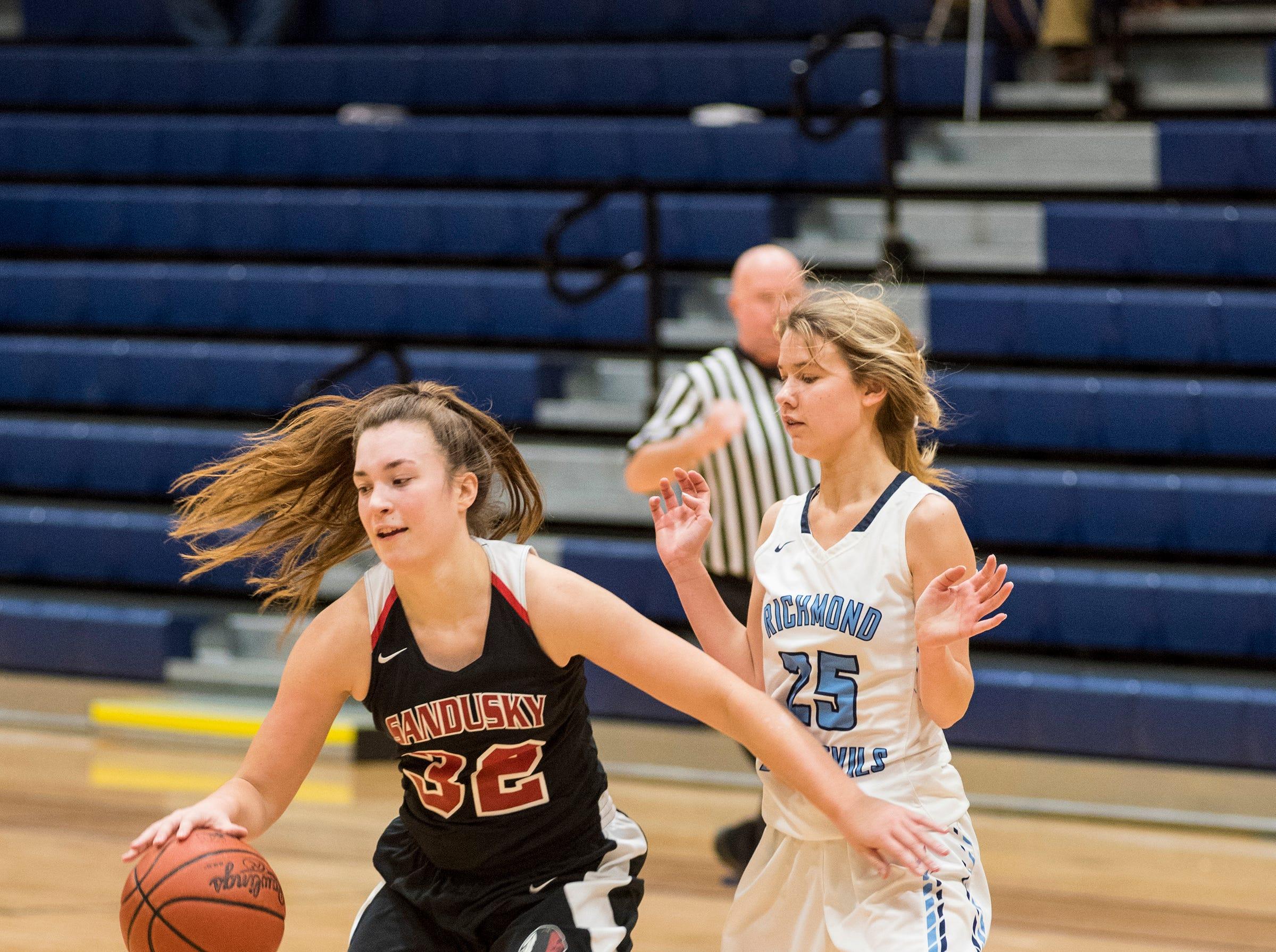 Richmond High School guanrd Jenna Schroeder (25) defends against Sandusky High School forward Gabby Gough during their SC4 Holiday Basketball Showcase game Thursday, Dec. 27, 2018 at the SC4 Fieldhouse.