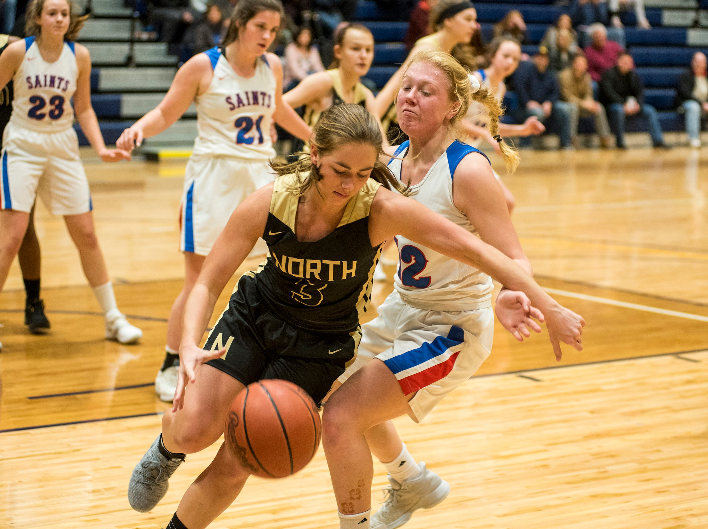 L'Anse Creuse North High School guard Alexandra Lavey (3) pushes around St. Clair High School forward Kra Donaldson during their SC4 Holiday Basketball Showcase game Thursday, Dec. 27, 2018 at the SC4 Fieldhouse.