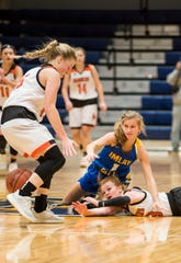 Marine City High School guard Erin Davis (15) misses a ball lost by guard Morgan McConnell as Imlay City High School guard Ana Lengemann (1) falls on her during their SC4 Holiday Basketball Showcase game Thursday, Dec. 27, 2018 at the SC4 Fieldhouse.