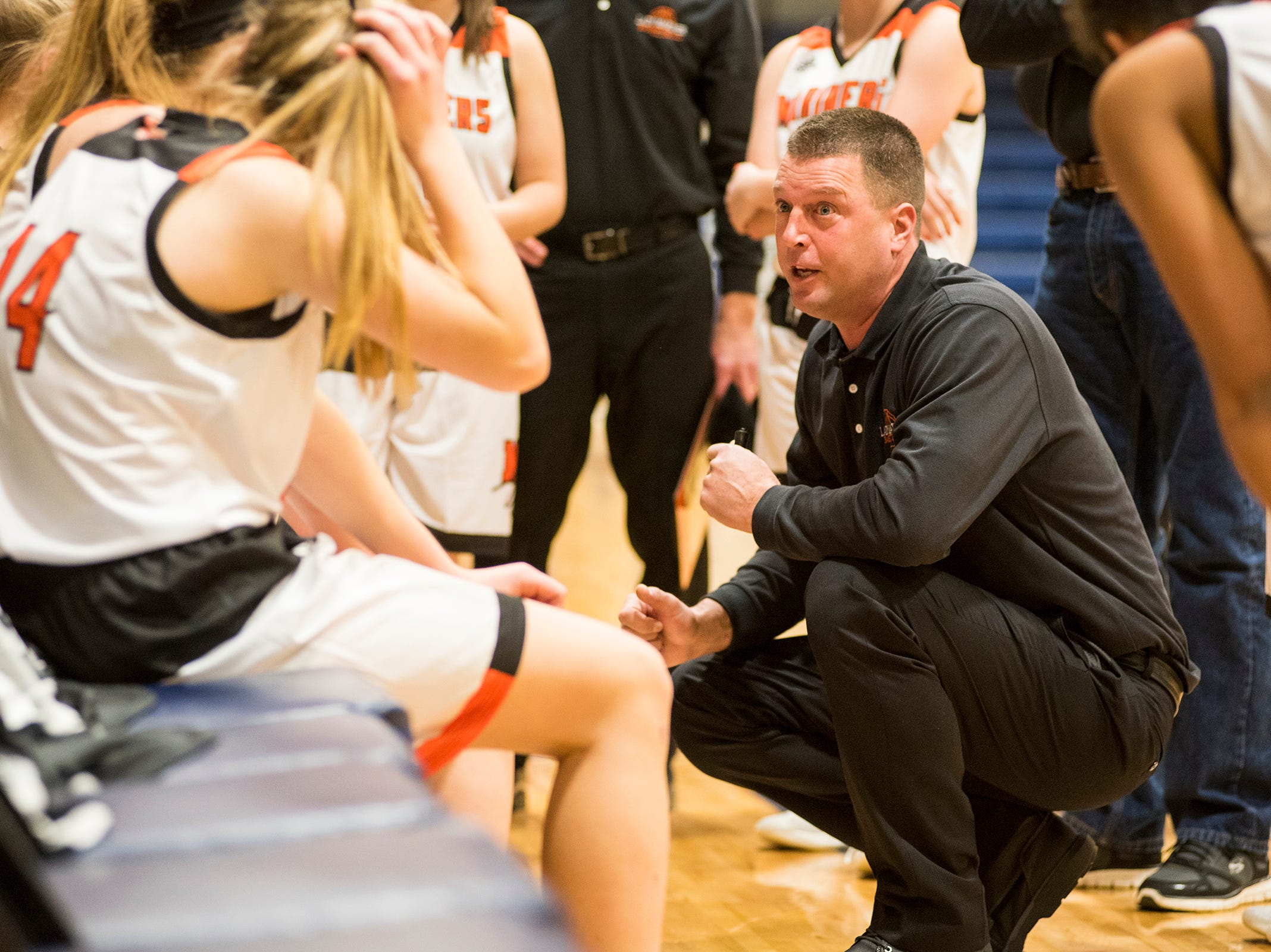 Marine City High School head basketball coach Jeff Austin talks to the team during a time out in their SC4 Holiday Basketball Showcase game against Imlay City High School Thursday, Dec. 27, 2018 at the SC4 Fieldhouse.