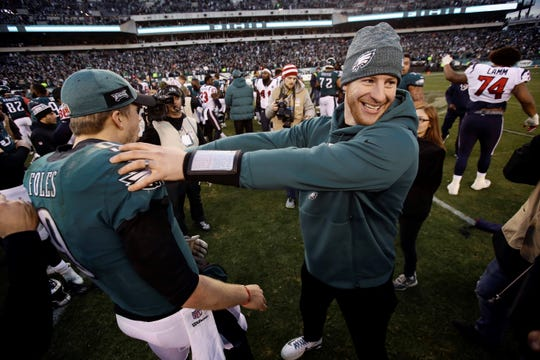 Philadelphia Eagles' Carson Wentz, right, and Nick Foles celebrate after an NFL football game against the Houston Texans, Sunday, Dec. 23, 2018, in Philadelphia. Philadelphia won 32-30. (AP Photo/Matt Rourke)