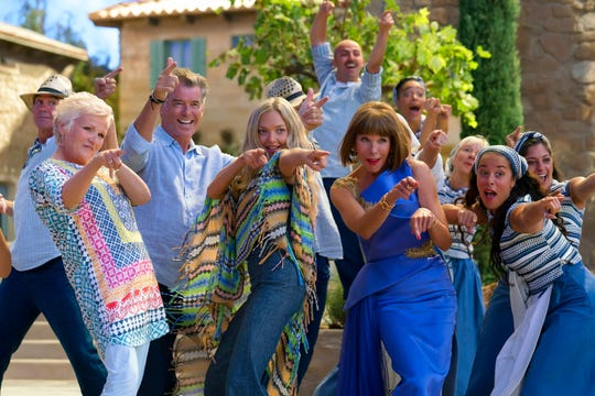 "Foreground from left, Julie Walters, Pierce Brosnan, Amanda Seyfried and Christine Baranski dance in ""Mamma Mia! Here We Go Again."" What does it all mean? Who cares? It's just fun."