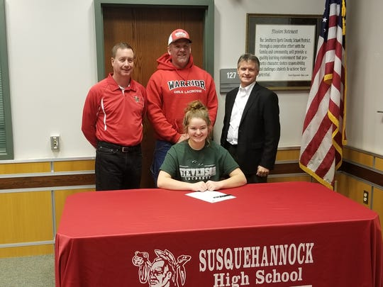 Susquehannock senior goalie Sam McGuire has signed to play lacrosse at Stevenson University. Behind her from the right are Susquehannock head coach Steve Marshner, Susquehannock assistant Greg Sisler and Shooting Irish club coach Dan China.