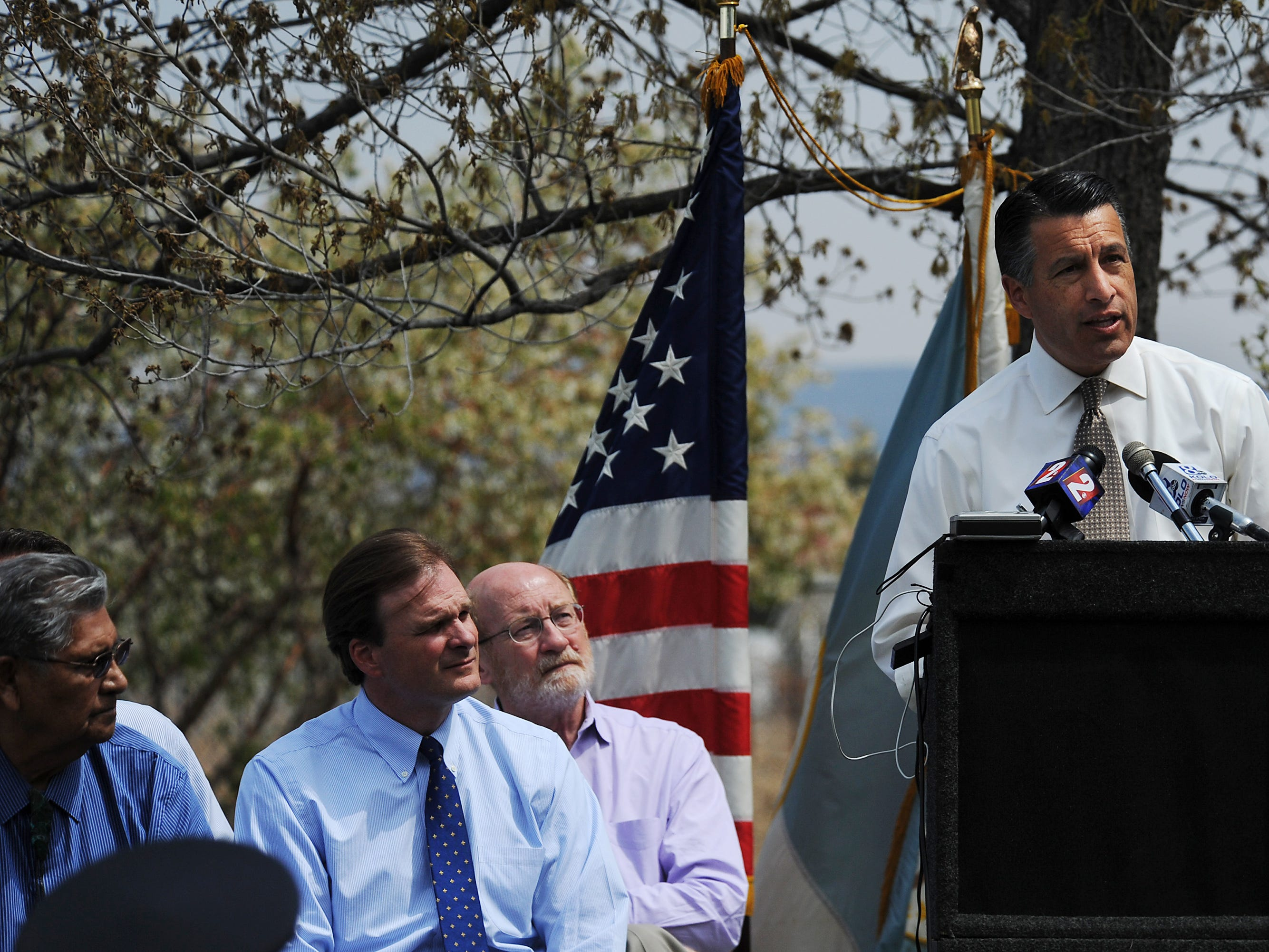 Nevada Governor Brian Sandoval speaks to those gathered during a press conference to announce that the Bi-State Sage Grouse will not be listed as threatened or endangered at the Nevada Dept. of Wildlife headquarters in Reno on April 21, 2015.
