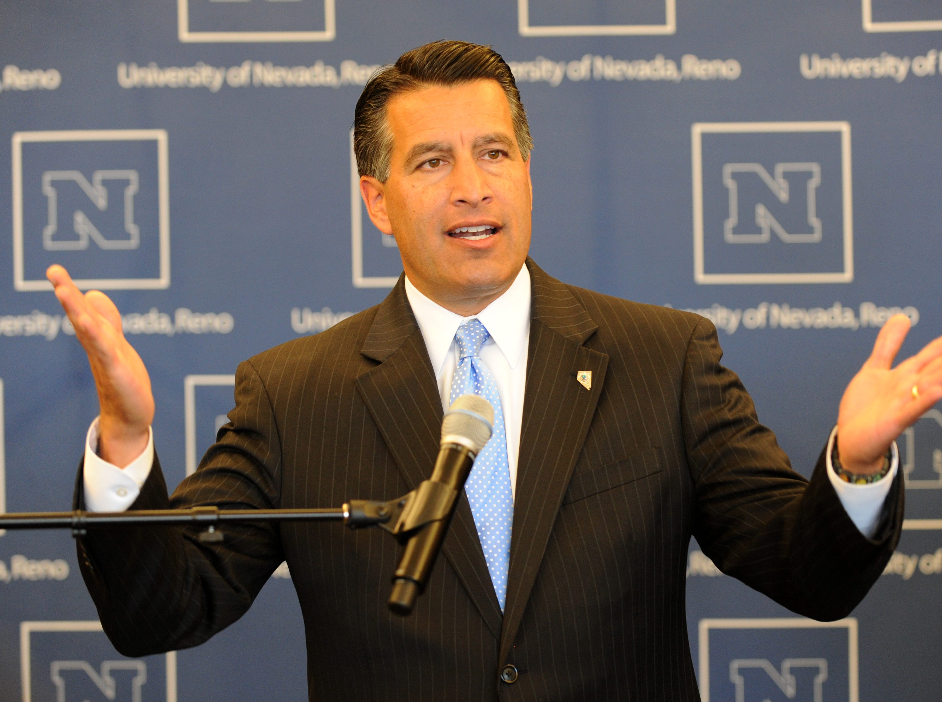 Gov. Brian Sandoval, seen here in a photo announcing the new fitness center at UNR, will likely name a new Nevada regent soon.  Photo by Tim Dunn/RGJ