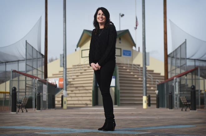 Reno's Cindy Watland poses for a portrait in front of the recently renovated Swope Field Pyramid on Dec. 22, 2018.