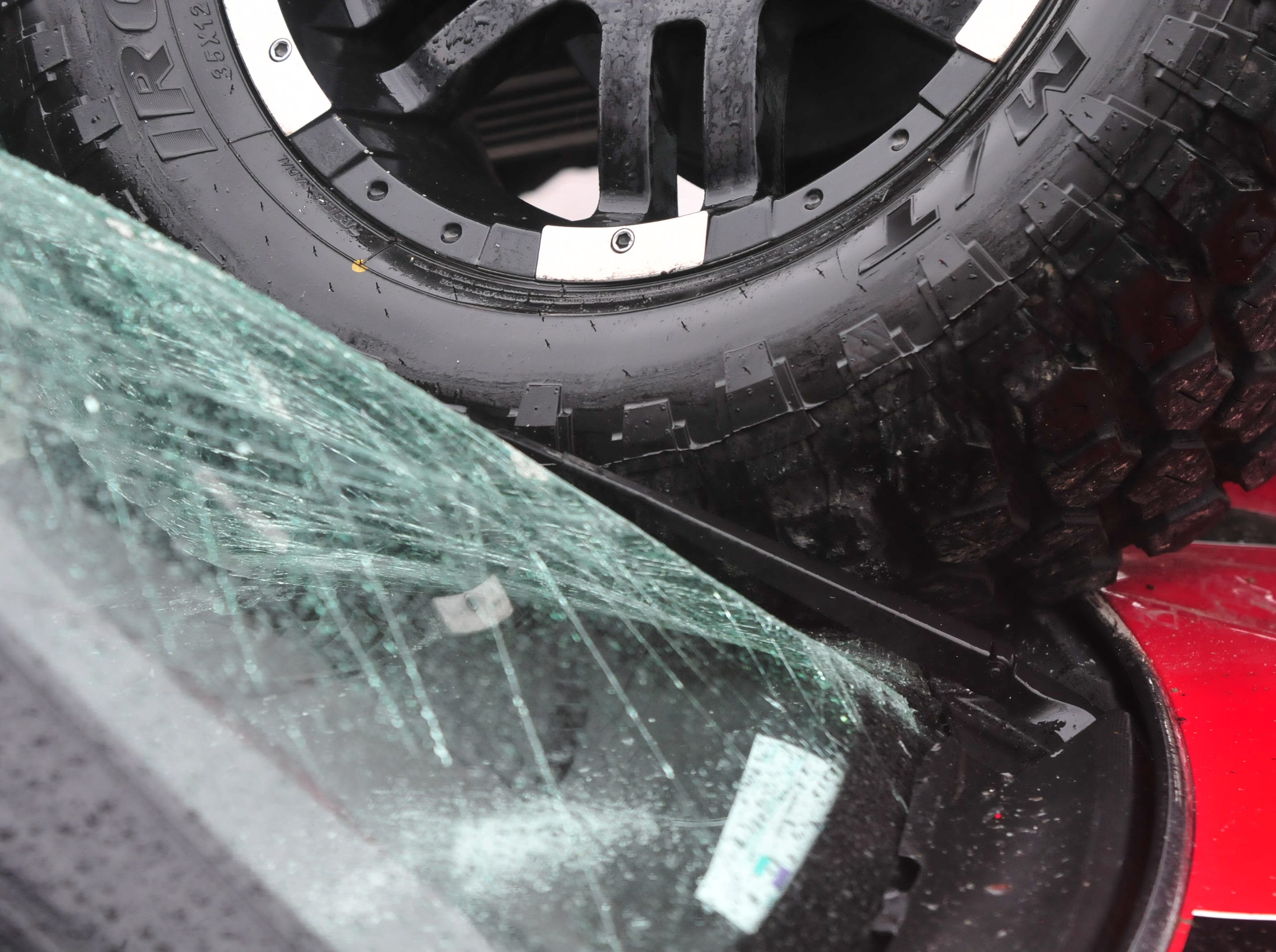 A pickup truck's tire smashed the windshield of a car Thursday during a three-vehicle accident on Indiana 121 at Hayes Arboretum Road.