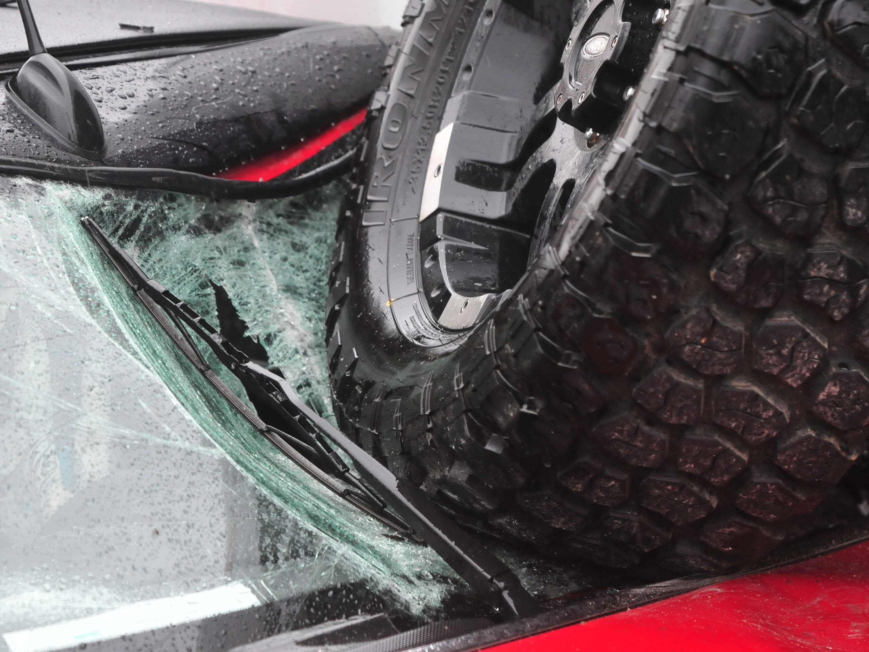 A tire smashed into the windshield of a car Thursday during a three-vehicle accident on Indiana 121 at Hayes Arboretum Road.