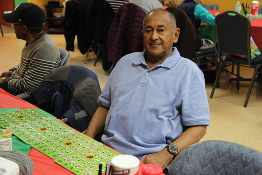 Jose Andres Nieves Ortiz plays bingo during at Ibero's Centro de Oro in Rochester on December 20. The 69-year-old native of Puerto Rico moved to Rochester earlier this year after Hurricane Maria decimated his community.