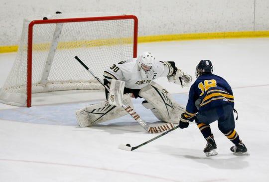 Rush-Henrietta goalie Cameron Kuzniar faces a shot attempt from Brighton/HFL/ER's Nolan Gangarosa in the third period at Scottsville Ice Arena.