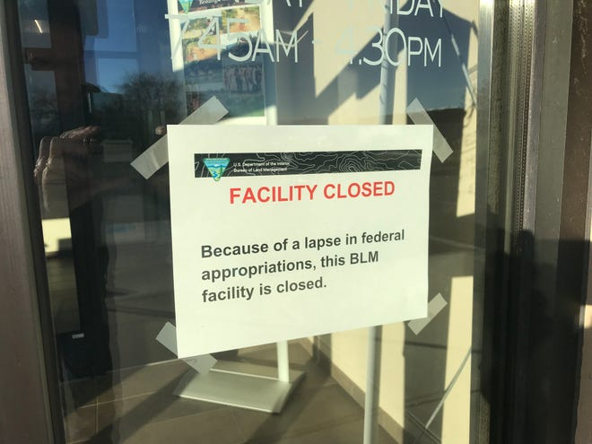 A sign at the entrance to the Redding Field Office of the U.S. Bureau of Land Management notified visitors Thursday that the office was closed due to a government shutdown.