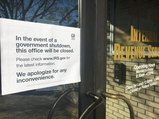A sign at the entrance to the Redding IRS office notified visitors Thursday that the office was closed due to a government shutdown.