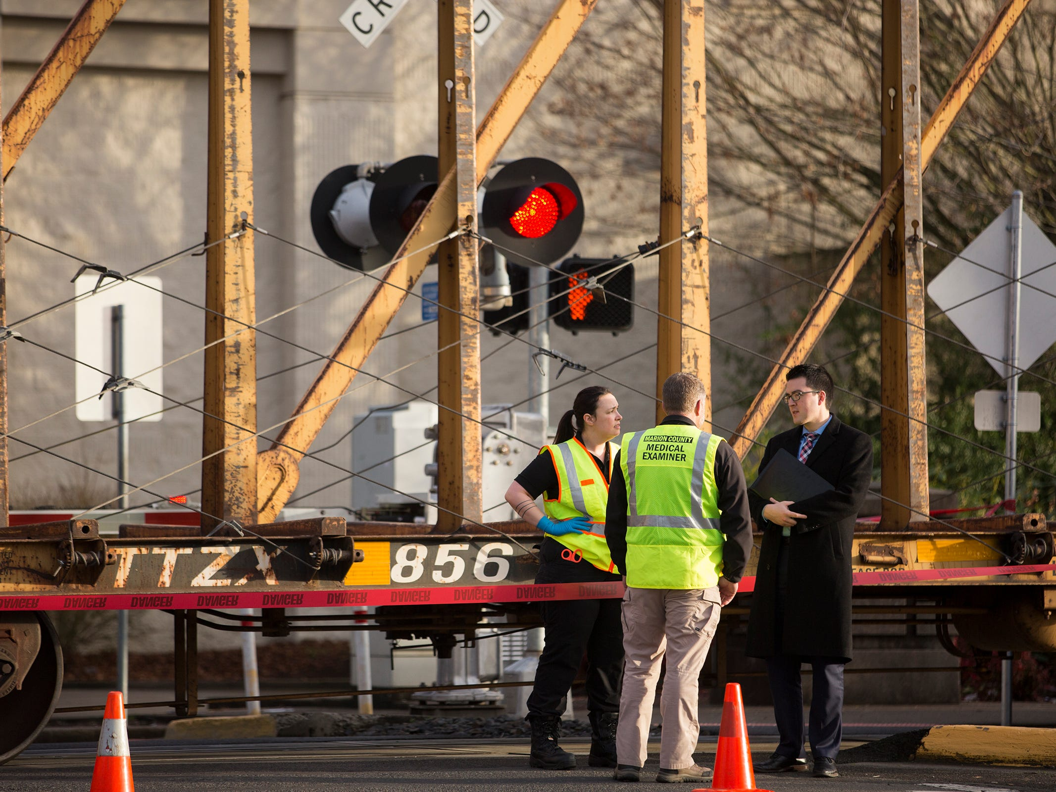 Officials investigate where a pedestrian was hit by a train at the intersection of Marion. St. NE and 12th St. on Thursday, Dec. 27, 2018.