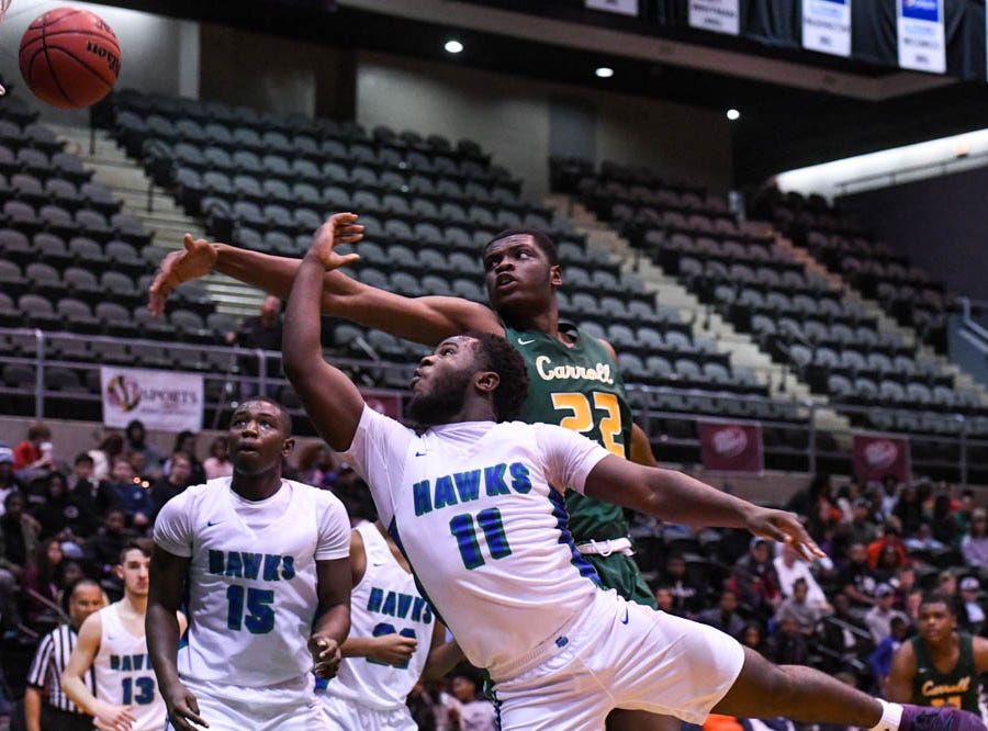 St. Georges' Tyrese Owens (11) moves the ball in a game against Archbishop Carroll during the Governor's Challenge basketball tournament at the Civic Center in Salisbury on Wednesday, Dec 26, 2018.