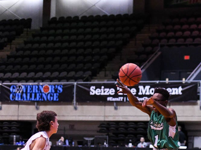 Parkside's Quamier Snell (1) goes up for a shot against Linganore in the Governor's Challenge basketball tournament at the Civic Center in Salisbury on Thursday, Dec 27, 2018.