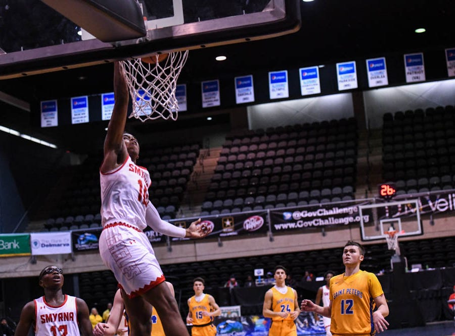 Smryna's Ron Jackson (10) goes up for a shot against St. Peter's in a Governor's Challenge basketball tournament game at the Civic Center in Salisbury on Wednesday, Dec 26, 2018.