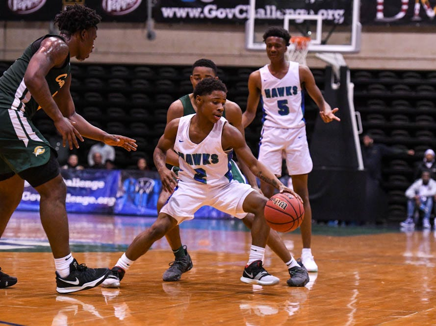 St. Georges' Lemar Wright (2) moves the ball in a game against Archbishop Carroll during the Governor's Challenge basketball tournament at the Civic Center in Salisbury on Wednesday, Dec 26, 2018.