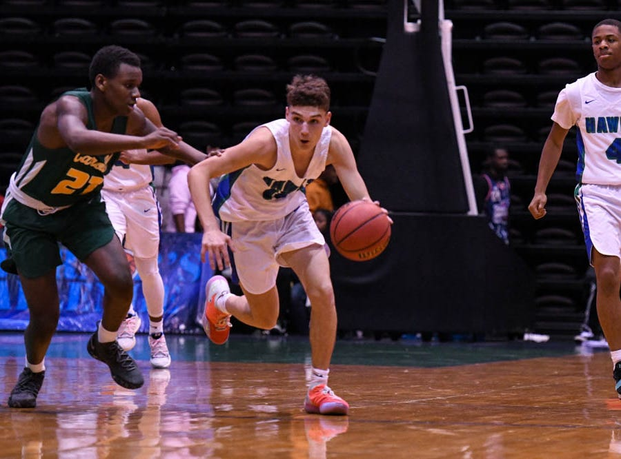 St. Georges' Blake Bryant (10) moves down the court in a game against Archbishop Carroll during the Governor's Challenge basketball tournament at the Civic Center in Salisbury on Wednesday, Dec 26, 2018.