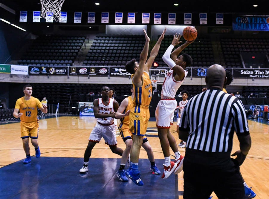 Smryna's Ron Jackson (10) goes up for a shot against St. Peter's Mike Loffredo (24) in a Governor's Challenge basketball tournament game at the Civic Center in Salisbury on Wednesday, Dec 26, 2018.