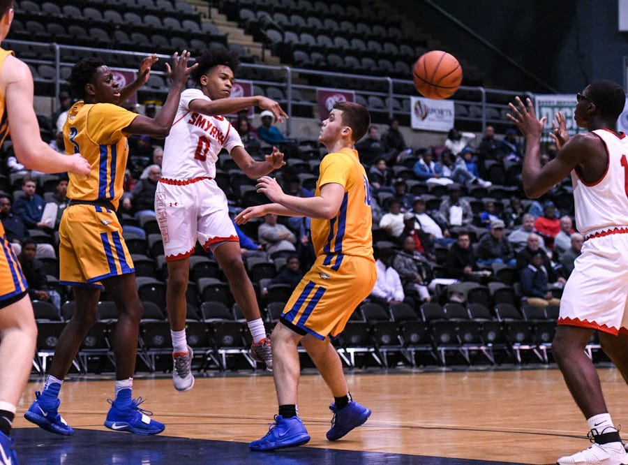 Smryna's DaVaughn Stanford (0) passes the ball against St. Peter's in a Governor's Challenge basketball tournament game at the Civic Center in Salisbury on Wednesday, Dec 26, 2018.