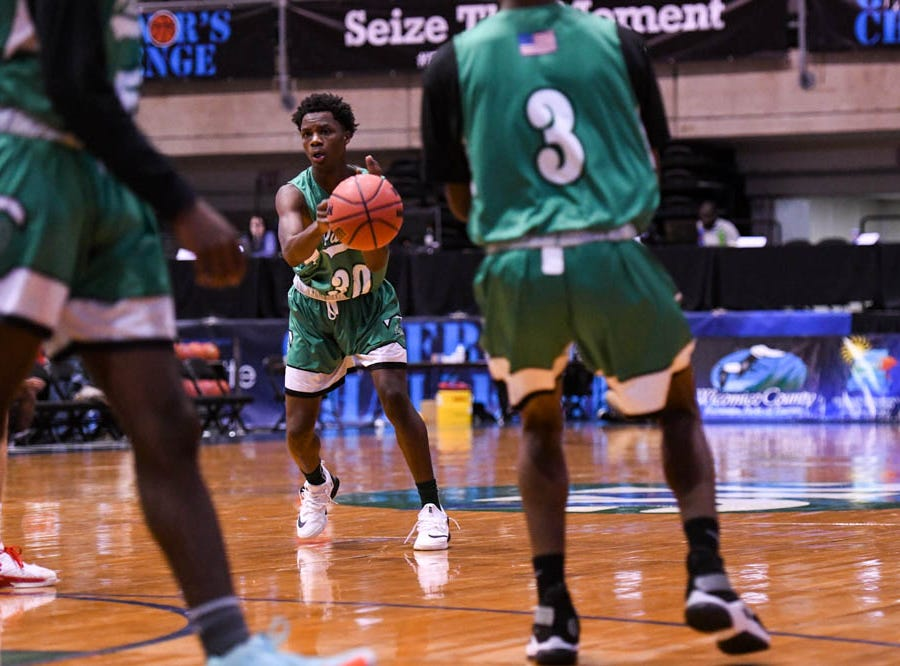 Parkside's Rashir Evans (30) moves the ball against Linganore in the Governor's Challenge basketball tournament at the Civic Center in Salisbury on Thursday, Dec 27, 2018.