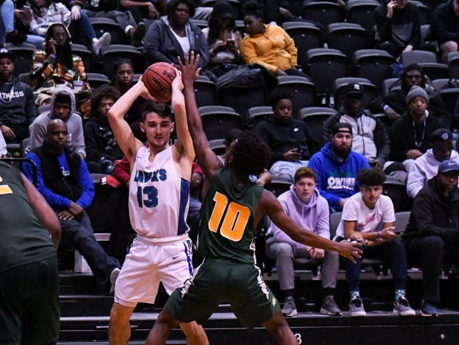 St. Georges' Joey Rinarelli (13) moves the ball in a game against Archbishop Carroll during the Governor's Challenge basketball tournament at the Civic Center in Salisbury on Wednesday, Dec 26, 2018.