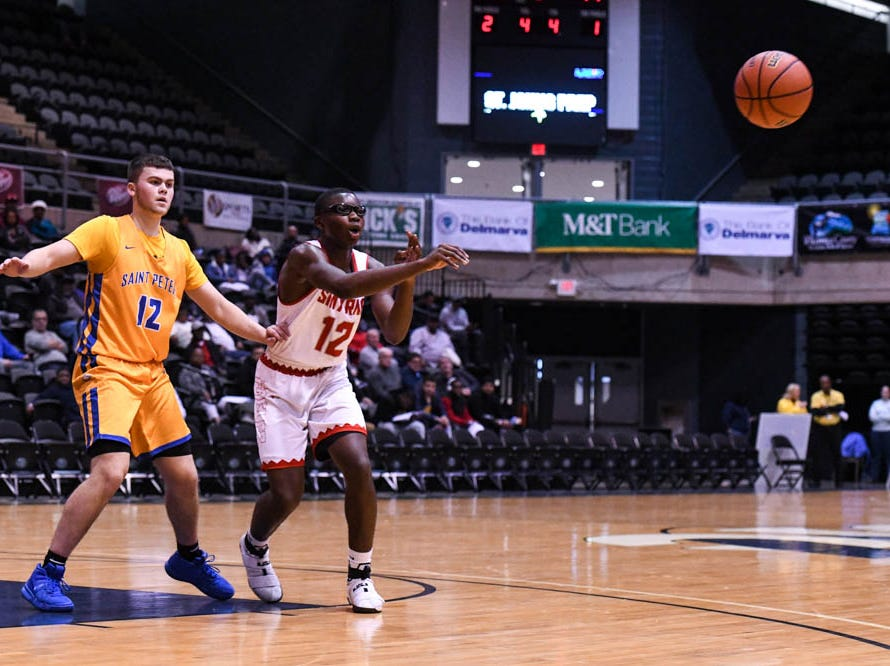 Smryna's Olumuyiwa Salako (12) passes the ball against St. Peter's in a Governor's Challenge basketball tournament game at the Civic Center in Salisbury on Wednesday, Dec 26, 2018.
