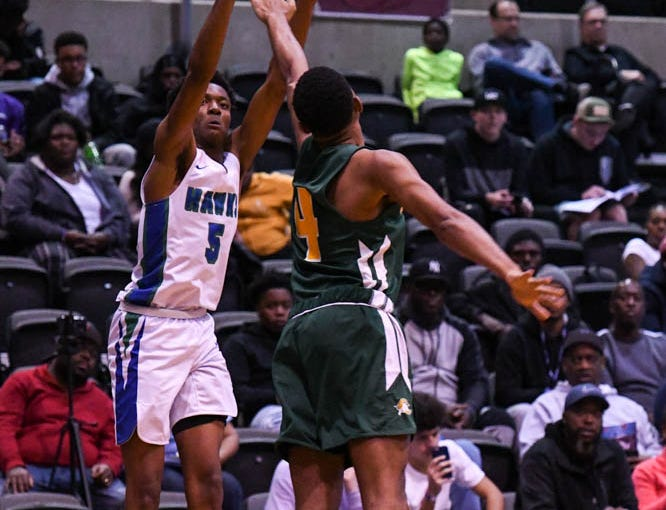 St. Georges' Nah'Shon Hyland (5) goes up for a shot in a game against Archbishop Carroll during the Governor's Challenge basketball tournament at the Civic Center in Salisbury on Wednesday, Dec 26, 2018.