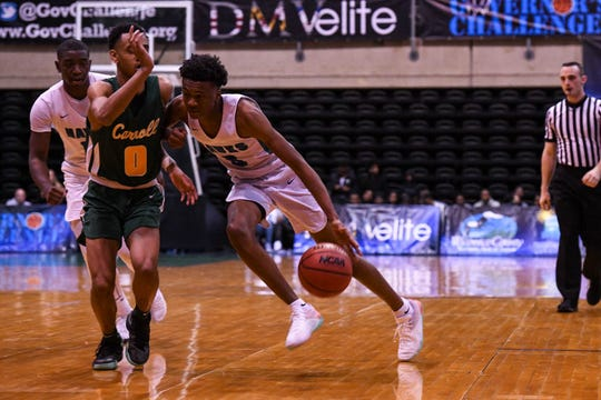 St. Georges' Nah'Shon Hyland (5) edges by the defense in a game against Archbishop Carroll during the Governor's Challenge basketball tournament at the Civic Center in Salisbury on Wednesday, Dec 26, 2018.