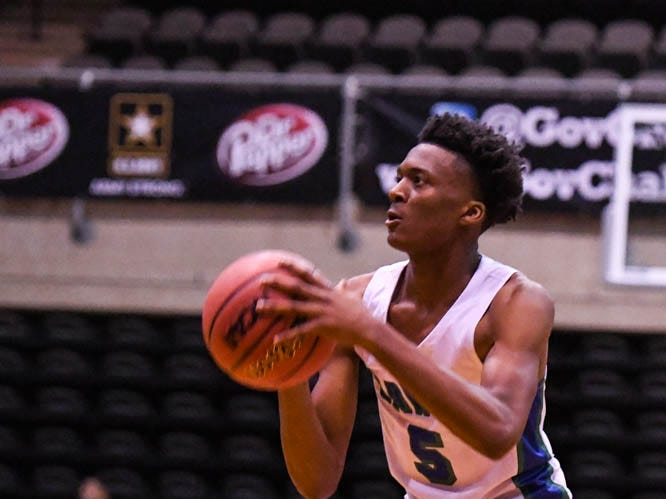 St. Georges' Nah'Shon Hyland (5) shoots the ball in a game against Archbishop Carroll during the Governor's Challenge basketball tournament at the Civic Center in Salisbury on Wednesday, Dec 26, 2018.