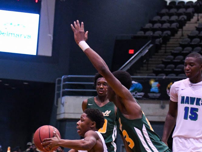St. Georges' Lemar Wright (2) fights through the defense in a game against Archbishop Carroll during the Governor's Challenge basketball tournament at the Civic Center in Salisbury on Wednesday, Dec 26, 2018.