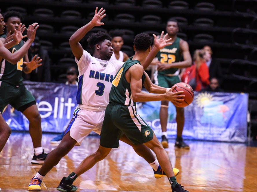 St. Georges' Merle Black (3) defends against Archbishop Carroll during the Governor's Challenge basketball tournament at the Civic Center in Salisbury on Wednesday, Dec 26, 2018.