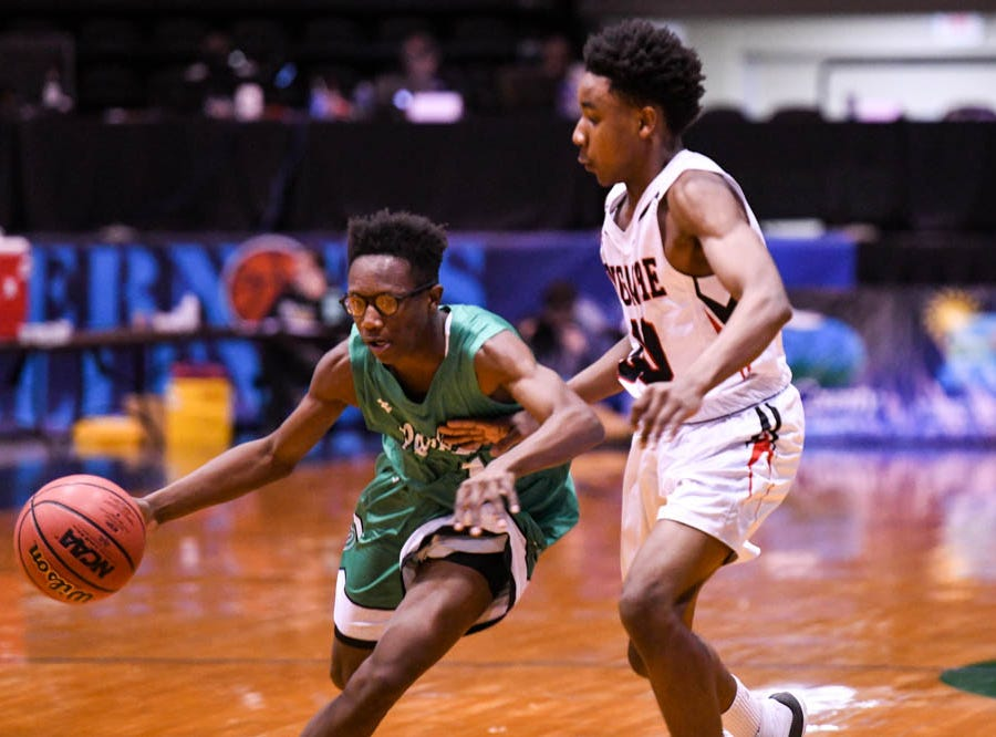 Parkside's Quamier Snell (1) moves the ball against Linganore in the Governor's Challenge basketball tournament at the Civic Center in Salisbury on Thursday, Dec 27, 2018.