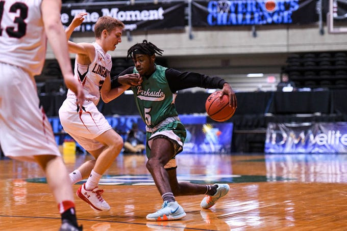 Parkside's Marcus Yarns (5) moves the ball against Linganore in the Governor's Challenge basketball tournament at the Civic Center in Salisbury on Thursday, Dec 27, 2018.